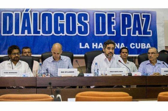 OVERHEID EN FARC BEREIKEN HISTORISCH AKKOORD